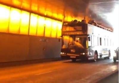 Tourist bus hits top of Paris tunnel, 4 injured, 1 serious