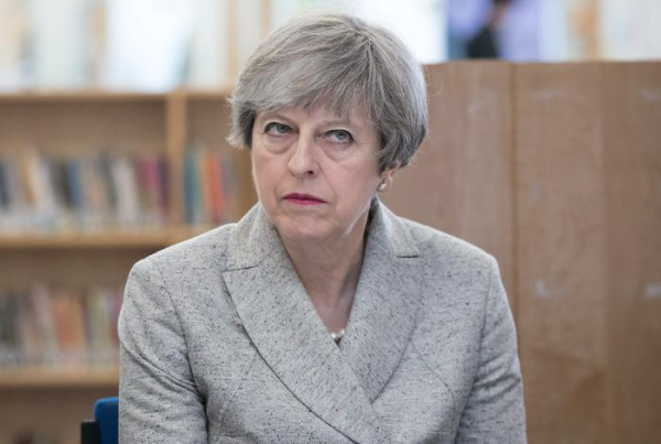 May 'shed tears' after losing majority in snap election