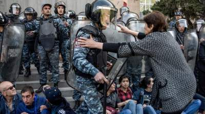 Armenia parliament swears in new PM despite protests