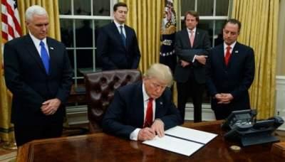 Trump signs defense authorization bill in New York visit